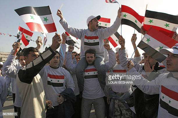Syrian people hold up their national flag as they demonstrate in Damascus in support of their government 24 November 2005 The United Nations said...