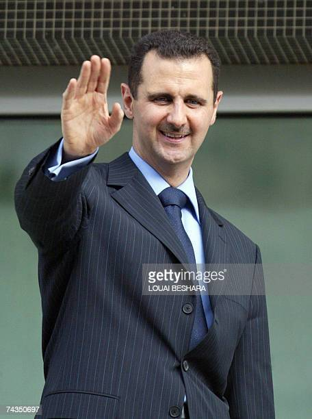 Syrian President Bashar alAssad waves to his supporting crowds from alRawda Palace in Damascus 29 May 2007 AlAssad has won a second sevenyear mandate...