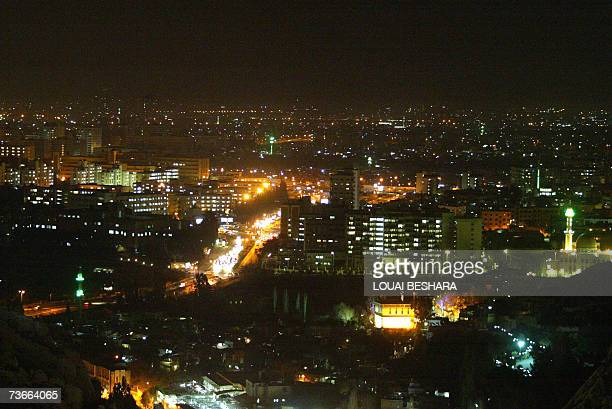 TO GO WITH STORY BY ROUEIDA MABARDIA A general view shows Damascus at night 21 March 2007 Rivalling those of London or Paris property prices and...