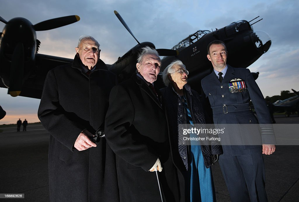 Dambuster veterans Les Munroe (L) George 'Johnny' Johnson (2nd left) Mary Stopes-Roe, the daughter of bouncing bomb inventor Barnes Wallace, and Wing Commander David Arthurton commanding officer of 617 Squadron, pose next to a Lancaster bomber as they take part in a Sunset Ceremony to mark the 70th anniversary of the World War II Dambusters mission at RAF Sccampton on May 16, 2013 in Lincoln, England. Ladybower and Derwent reservoirs were used by the RAF's 617 Squadron in 1943 to test Sir Barnes Wallis' bouncing bomb before their mission to destroy dams in Germany's Ruhr Valley. Today marks the 70th anniversary of the famous Dambuster mission and will be watched by veterans from the original campaign.