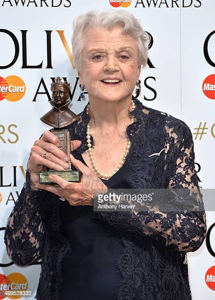 Dame Angela Lansbury poses in the winners room at The Olivier Awards at The Royal Opera House on April 12 2015 in London England