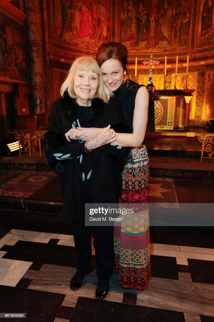 Dame Diana Rigg and Rachael Stirling attend Macmillan Cancer Support's Guards' Chapel Christmas Carol Concert at Wellington Barracks on December 7, 2017 in London, England.