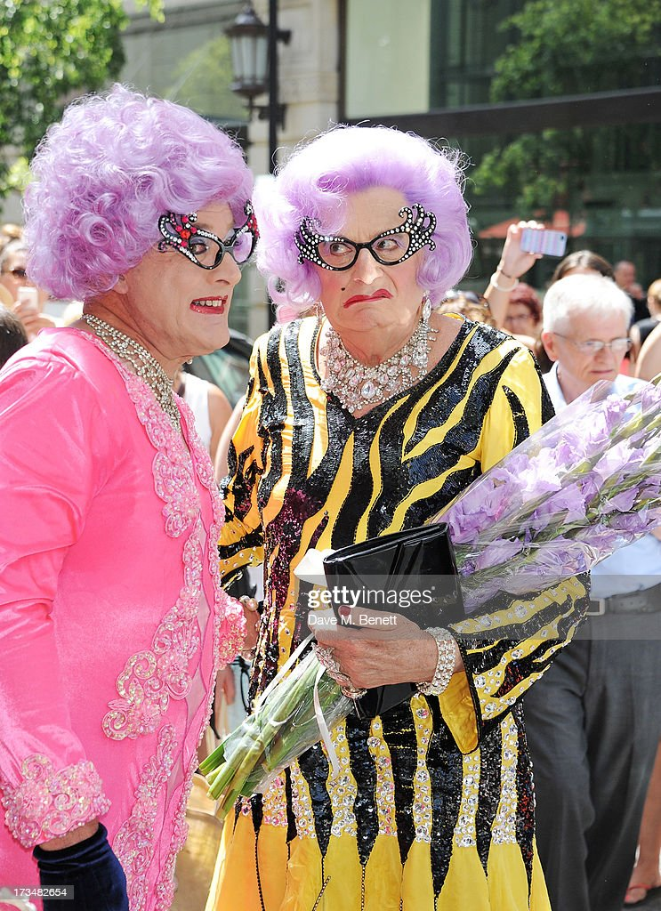Dame Edna Everage aka <a gi-track='captionPersonalityLinkClicked' href=/galleries/search?phrase=Barry+Humphries&family=editorial&specificpeople=206650 ng-click='$event.stopPropagation()'>Barry Humphries</a> (R) launches '<a gi-track='captionPersonalityLinkClicked' href=/galleries/search?phrase=Barry+Humphries&family=editorial&specificpeople=206650 ng-click='$event.stopPropagation()'>Barry Humphries</a>' Farewell Tour: Eat, Pray, Laugh'' at the London Palladium on July 15, 2013 in London, England.