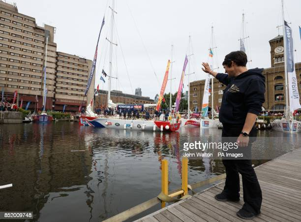 Dame Ellen MacArthur waves off the Great Britain crew during the start of the Clipper Round the World Race at St Katharine Docks London