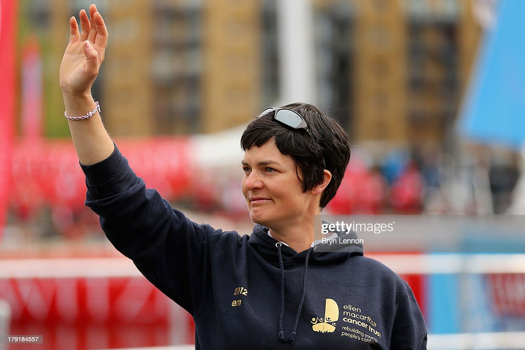 Dame Ellen MacArthur waves to the Great Britain team as they exit St Katherine's docks at the start of the Clipper Round The World Yacht Race at Tower Bridge on September 1, 2013 in London, England.