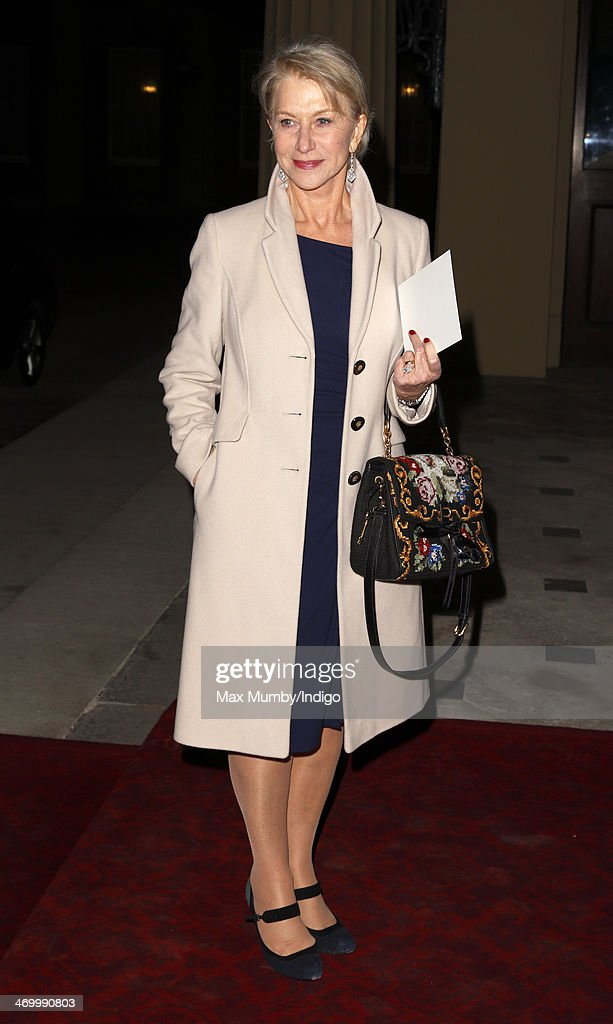 Dame Helen Mirren attends a Dramatic Arts reception hosted by Queen Elizabeth II at Buckingham Palace on February 17 2014 in London England