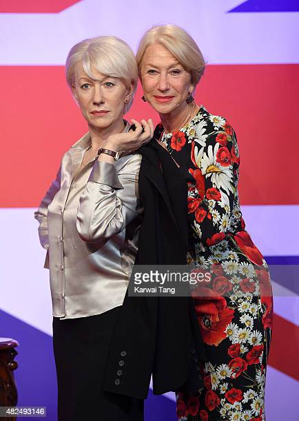 Dame Helen Mirren comes face to face with three waxwork figures of herself today at Madame Tussauds on July 30 2015 in London England