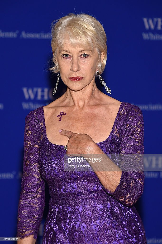 Dame <a gi-track='captionPersonalityLinkClicked' href=/galleries/search?phrase=Helen+Mirren&family=editorial&specificpeople=201576 ng-click='$event.stopPropagation()'>Helen Mirren</a> indicates a symbol honoring the late musician Prince on her shoulder as she attemds the the 102nd White House Correspondents' Association Dinner on April 30, 2016 in Washington, DC.