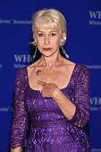 Dame Helen Mirren indicates a symbol honoring the late musician Prince on her shoulder as she attemds the the 102nd White House Correspondents'...