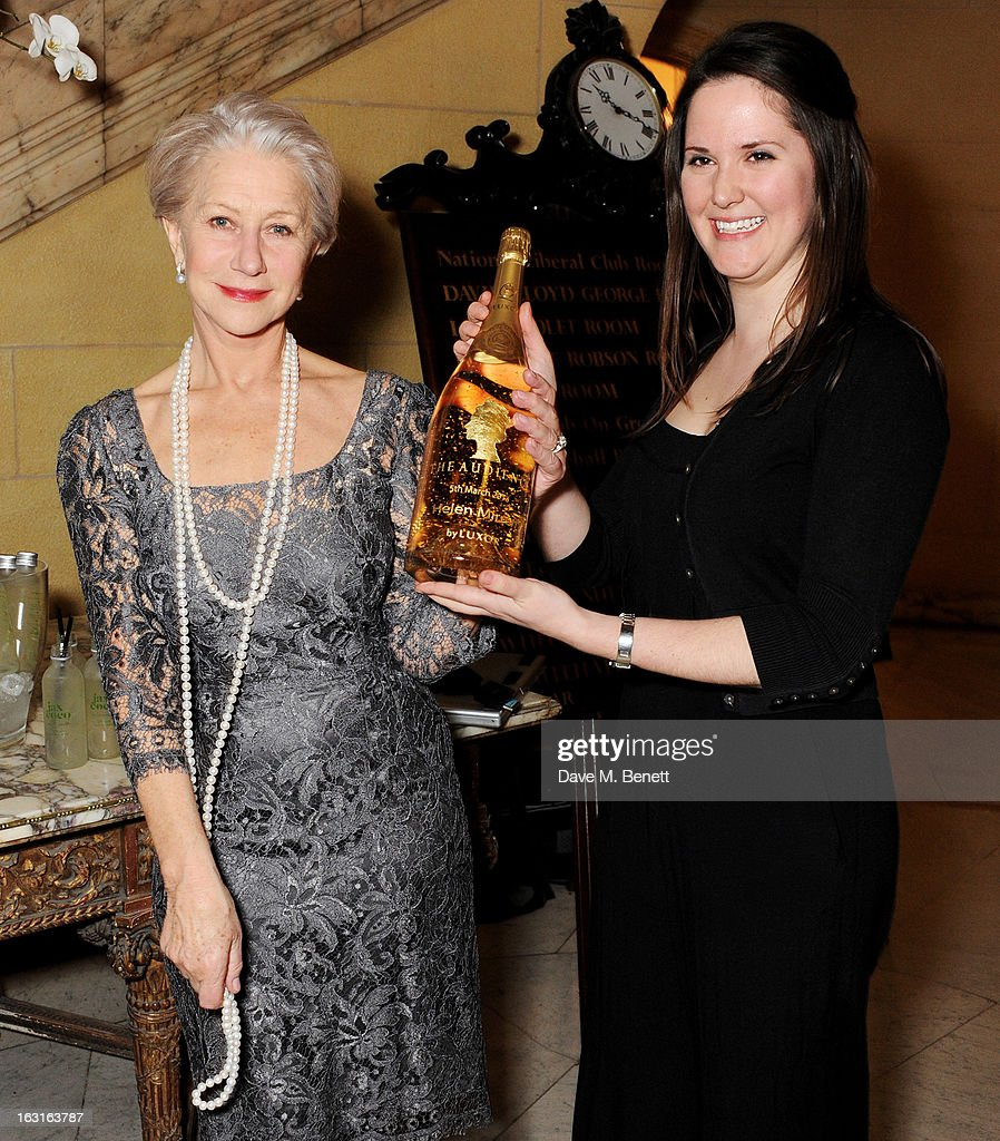 Dame Helen Mirren is presented a custom bottle of Luxor champagne at an after party following the press night performance of 'The Audience' at One Whitehall Place on March 5, 2013 in London, England.