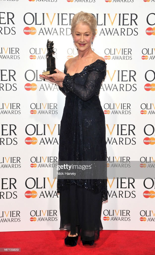 Dame <a gi-track='captionPersonalityLinkClicked' href=/galleries/search?phrase=Helen+Mirren&family=editorial&specificpeople=201576 ng-click='$event.stopPropagation()'>Helen Mirren</a> poses with her award at The Laurence Olivier Awards at The Royal Opera House on April 28, 2013 in London, England.