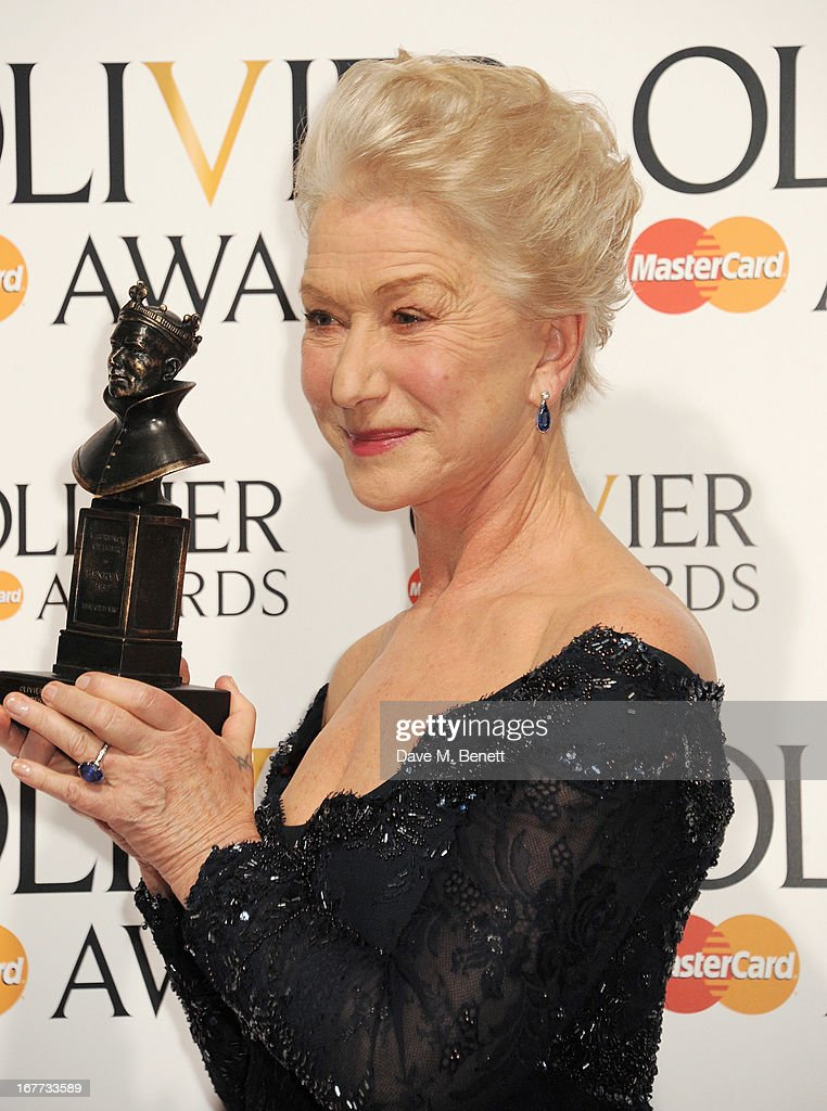Dame Helen Mirren, winner of Best Actress, poses in the press room at The Laurence Olivier Awards 2013 at The Royal Opera House on April 28, 2013 in London, England.