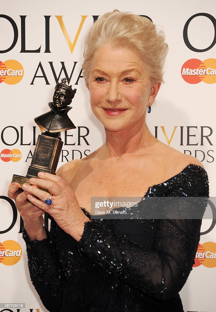 Dame Helen Mirren, winner of the Best Actress award, poses in the press room at The Laurence Olivier Awards 2013 at The Royal Opera House on April 28, 2013 in London, England.