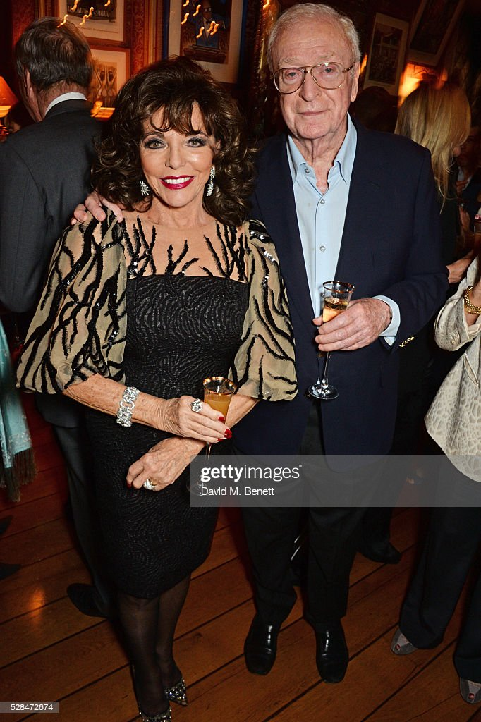 Dame Joan Collins (L) and Sir Michael Caine attend the launch of Dame Joan Collins' new book 'The St. Tropez Lonely Hearts Club' at Harry's Bar on May 5, 2016 in London, England.
