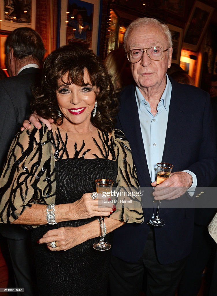 Dame <a gi-track='captionPersonalityLinkClicked' href=/galleries/search?phrase=Joan+Collins&family=editorial&specificpeople=109065 ng-click='$event.stopPropagation()'>Joan Collins</a> (L) and Sir <a gi-track='captionPersonalityLinkClicked' href=/galleries/search?phrase=Michael+Caine+-+Actor&family=editorial&specificpeople=159746 ng-click='$event.stopPropagation()'>Michael Caine</a> attend the launch of Dame <a gi-track='captionPersonalityLinkClicked' href=/galleries/search?phrase=Joan+Collins&family=editorial&specificpeople=109065 ng-click='$event.stopPropagation()'>Joan Collins</a>' new book 'The St. Tropez Lonely Hearts Club' at Harry's Bar on May 5, 2016 in London, England.