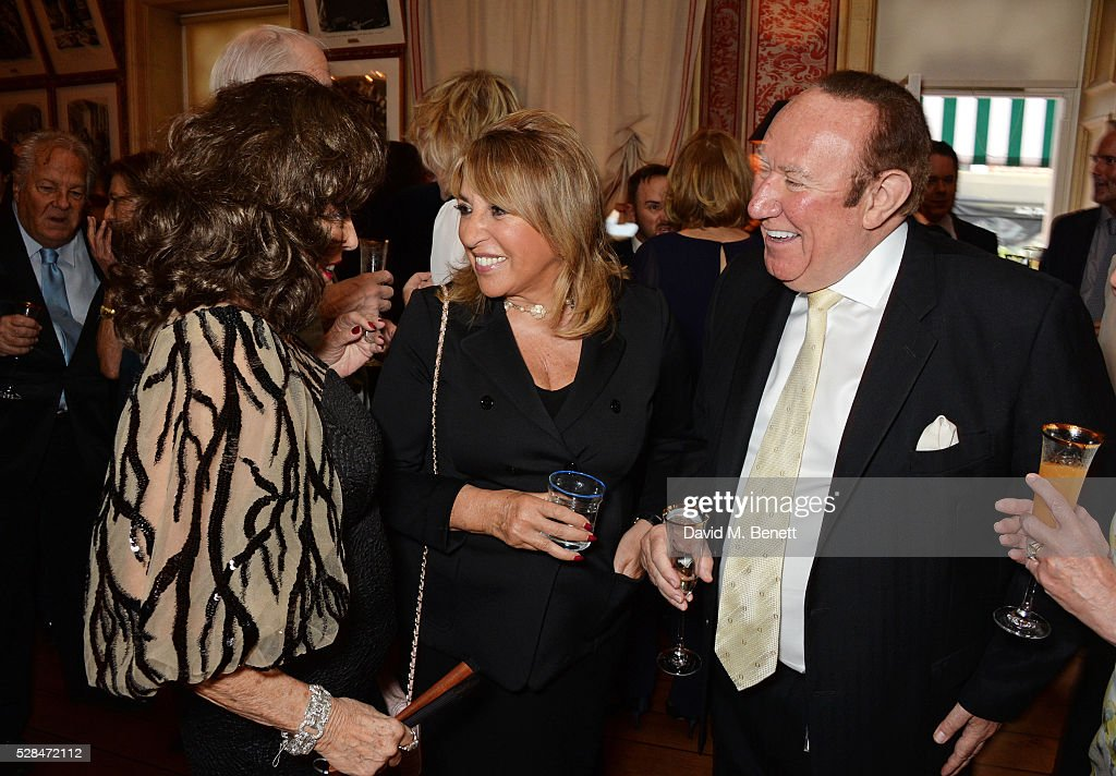 Dame Joan Collins, Eve Pollard and Andrew Neil attend the launch of Dame Joan Collins' new book 'The St. Tropez Lonely Hearts Club' at Harry's Bar on May 5, 2016 in London, England.