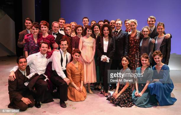 Dame Joan Collins poses backstage with cast members including Jane Asher of the West End production of 'An American In Paris' at The Dominion Theatre...