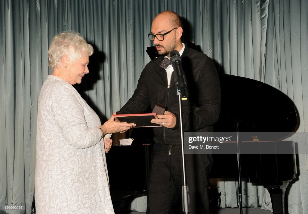 Dame Judi Dench (L) accepts the Moscow Art Theatre's Golden Seagull award at the 58th London Evening Standard Theatre Awards in association with Burberry at The Savoy Hotel on November 25, 2012 in London, England.