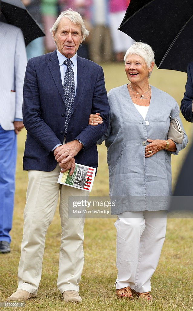 Dame Judi Dench and David Mills accompany Prince Charles, Prince of Wales and Camilla, Duchess of Cornwall on a visit to the 132nd Sandringham Flower Show at Sandringham House on July 31, 2013 in King's Lynn, England.