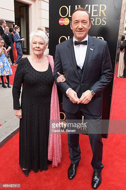 Dame Judi Dench and Kevin Spacey attend The Olivier Awards at The Royal Opera House on April 12 2015 in London England