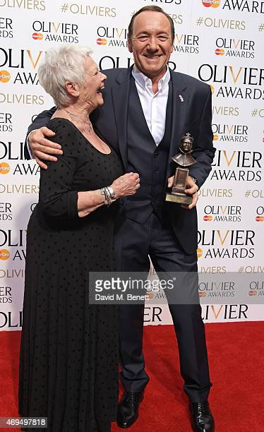 Dame Judi Dench and Kevin Spacey winner of the Special Award pose in the winners room at The Olivier Awards at The Royal Opera House on April 12 2015...