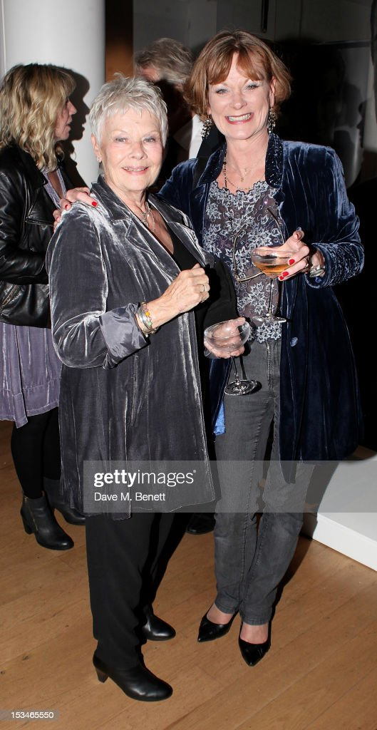 Dame Judi Dench and Samantha Bond attend '50 Years Of James Bond The Auction' celebrating the 50th anniversary of the film franchise and the first...