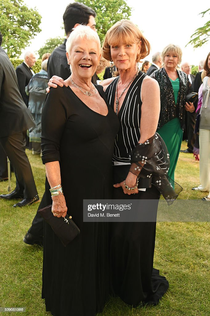 Dame Judi Dench and Samantha Bond attend the Duke of Edinburgh Award 60th Anniversary Diamonds are Forever Gala at Stoke Park on June 9 2016 in...