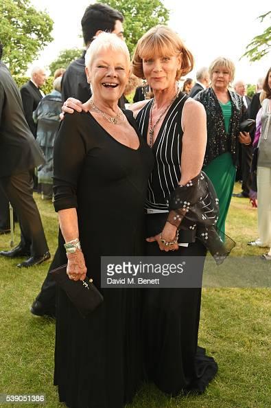Dame Judi Dench and Samantha Bond attend the Duke of Edinburgh Award 60th Anniversary Diamonds are Forever Gala at Stoke Park on June 9 2016 in...