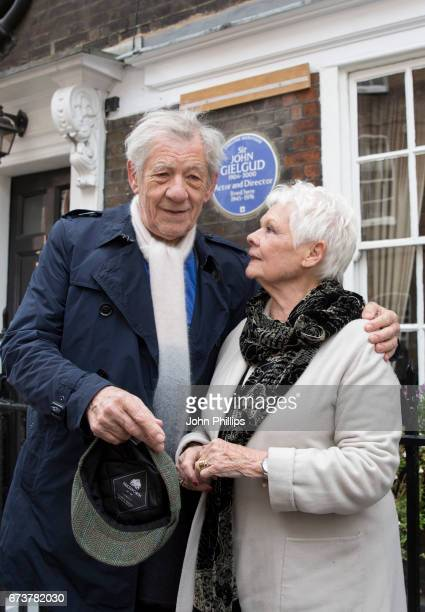 Dame Judi Dench and Sir Ian McKellen during the unveiling of a new plaque commemorating her friend and fellow actor Sir John Gielgud on Cowley Street...