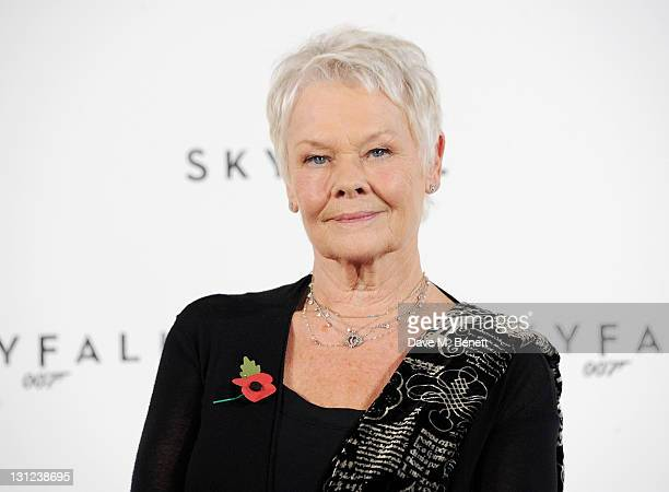 Dame Judi Dench attends a photocall with cast and filmmakers to mark the start of production which is due to commence on the 23rd Bond Film and...