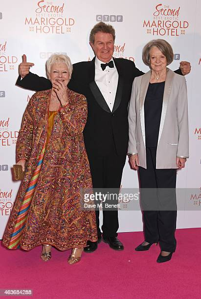 Dame Judi Dench director John Madden and Dame Maggie Smith attend The Royal Film Performance and World Premiere of 'The Second Best Exotic Marigold...