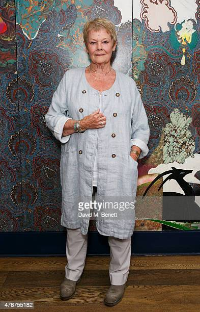 Dame Judi Dench poses following an 'In Conversation' with Sir Richard Eyre at The Hospital Club as part of the Mountview Academy's 70th birthday...
