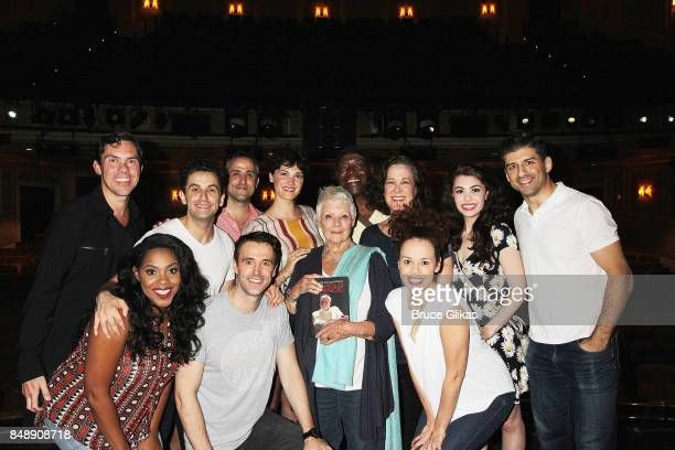 Dame Judi Dench poses with the cast backstage at the hit musical 'Prince of Broadway' on Broadway at The Manhattan Theatre Club's Samuel J Friedman...