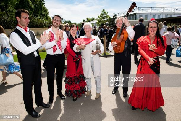 Dame Judi Dench poses with traditional Spanish flamenco dancers at the RHS Chelsea Flower Show on May 22 2017 in London United Kingdom With Their...