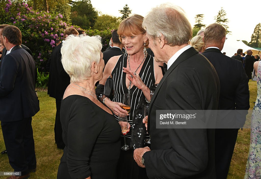 Dame Judi Dench Samantha Bond and David Mills attend the Duke of Edinburgh Award 60th Anniversary Diamonds are Forever Gala at Stoke Park on June 9...