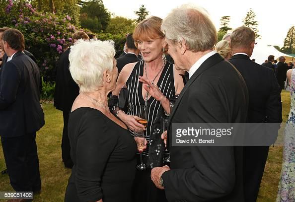 Dame Judi Dench Samantha Bond and David Mills attend the Duke of Edinburgh Award 60th Anniversary Diamonds are Forever Gala at Stoke Park on June 9...