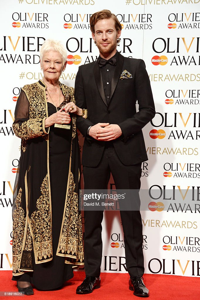 Dame Judi Dench winner of the Best Actress In A Supporting Role award for 'The Winter's Tale' and presenter Luke Treadaway pose in the Winners Room...