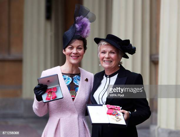 Dame Julie Walters and Helen McCrory pose after they awarded a Damehood and OBE respectively by Queen Elizabeth II at an Investiture ceremony at...
