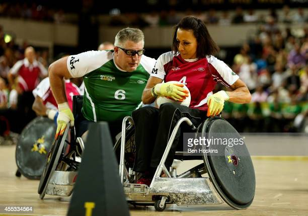 Dame Kelly Holmes of team Endevour holds off pressure from Dennis Ramsay of team Invictus during Day Two of the Invictus Games at Olympic Park on...