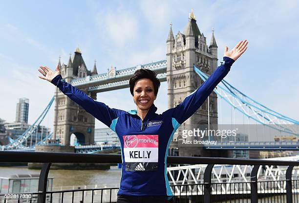 Dame Kelly Holmes poses in front of Tower Bridge as she attends a photocall ahead of the Virgin Money London Marathon at The Tower Hotel on April 21...
