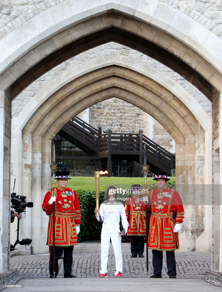 Dame <a gi-track='captionPersonalityLinkClicked' href=/galleries/search?phrase=Kelly+Holmes&family=editorial&specificpeople=213496 ng-click='$event.stopPropagation()'>Kelly Holmes</a> poses with Beefeaters in the Tower of London during the London 2012 Olympic Torch Relay on July 20, 2012 in London, England. The Olympic Flame is now on day 63 of a 70-day relay involving 8,000 torchbearers covering 8,000 miles.