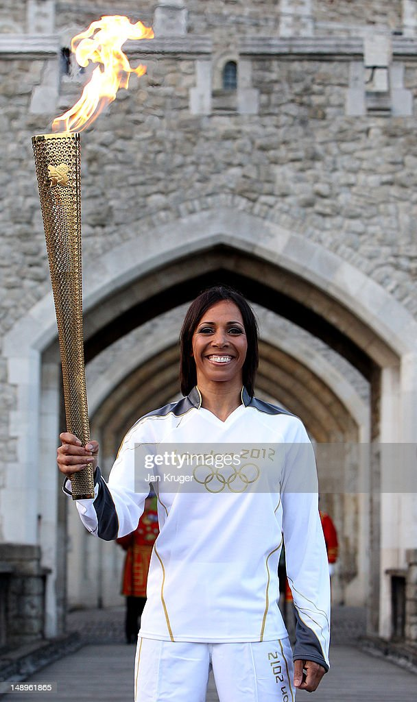 <a gi-track='captionPersonalityLinkClicked' href=/galleries/search?phrase=Dame+Kelly+Holmes&family=editorial&specificpeople=213496 ng-click='$event.stopPropagation()'>Dame Kelly Holmes</a> poses with the Olympic Torch in the Tower of London during the London 2012 Olympic Torch Relay on July 20, 2012 in London, England. The Olympic Flame is now on day 63 of a 70-day relay involving 8,000 torchbearers covering 8,000 miles.