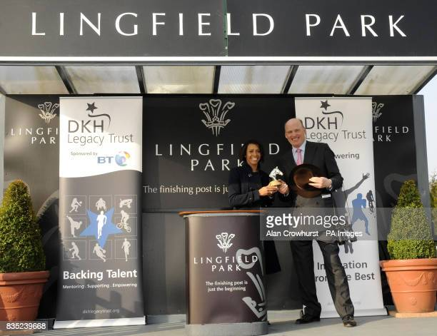 Dame Kelly Holmes presents a trophy to trainer John Gosden after his horse Debussy won The Dame Kelly Holmes Legacy Trust Maiden Stakes during the...