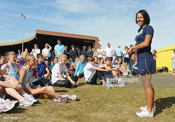 Dame Kelly Holmes talks to some of the athletes during day two of the Aviva English Schools Track and Field Championships at the Alexander Stadium on...