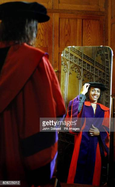 Dame Kelly Holmes the double Olympic gold medal winner in the robing room at Rochester Cathedral before being presented with an honorary degree as...