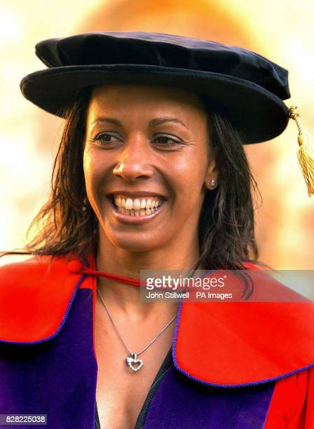 Dame Kelly Holmes the double Olympic gold medal winner wearing a cap and gown before receiving her honorary degree as Doctor of Civil Law at...