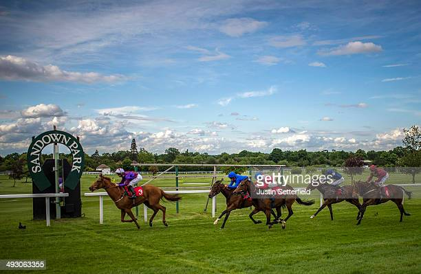 Dame Liberty ridden by Pat Dobbs win the Dynamyx British Stallion Studs EBF Maiden Fillies' Stakes at Sandown Park on May 22 2014 in Esher England