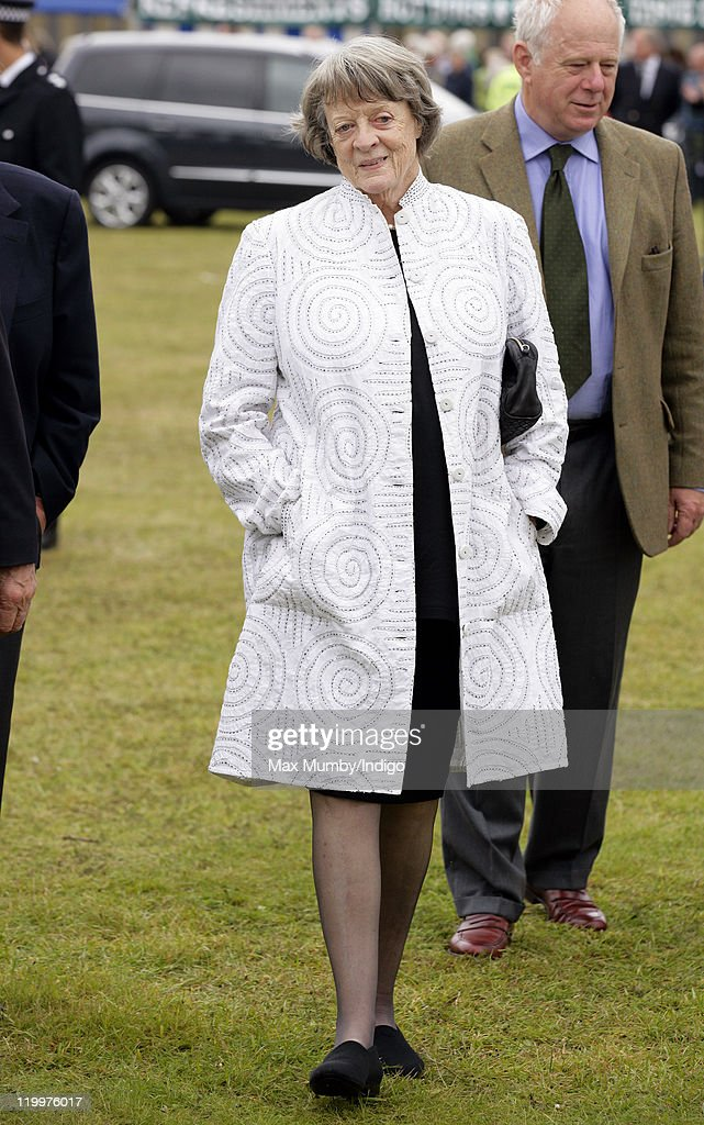 Dame Maggie Smith accompanies Prince Charles, Prince of Wales and Camilla, Duchess of Cornwall as they visit the 130th Sandringham Flower Show on July 27, 2011 in Huntingdon, England.