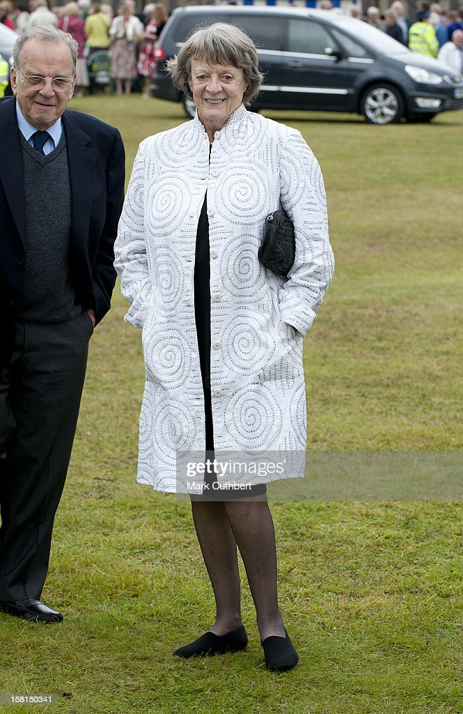 Dame Maggie Smith Joins The Prince Of Wales And The Duchess Of Cornwall As They Visit The 130Th Sandringham Flower Show, Norfolk.