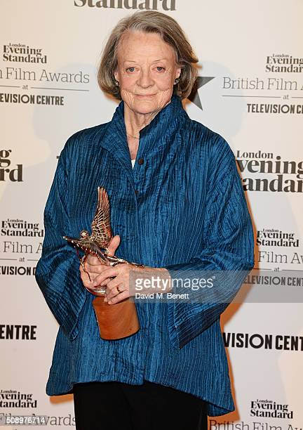 Dame Maggie Smith winner of the Best Actress award for 'The Lady In The Van' poses in front of the Winners Boards at the London Evening Standard...
